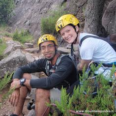 Raj and Sara rock climbing in Rogno, Lake Iseo